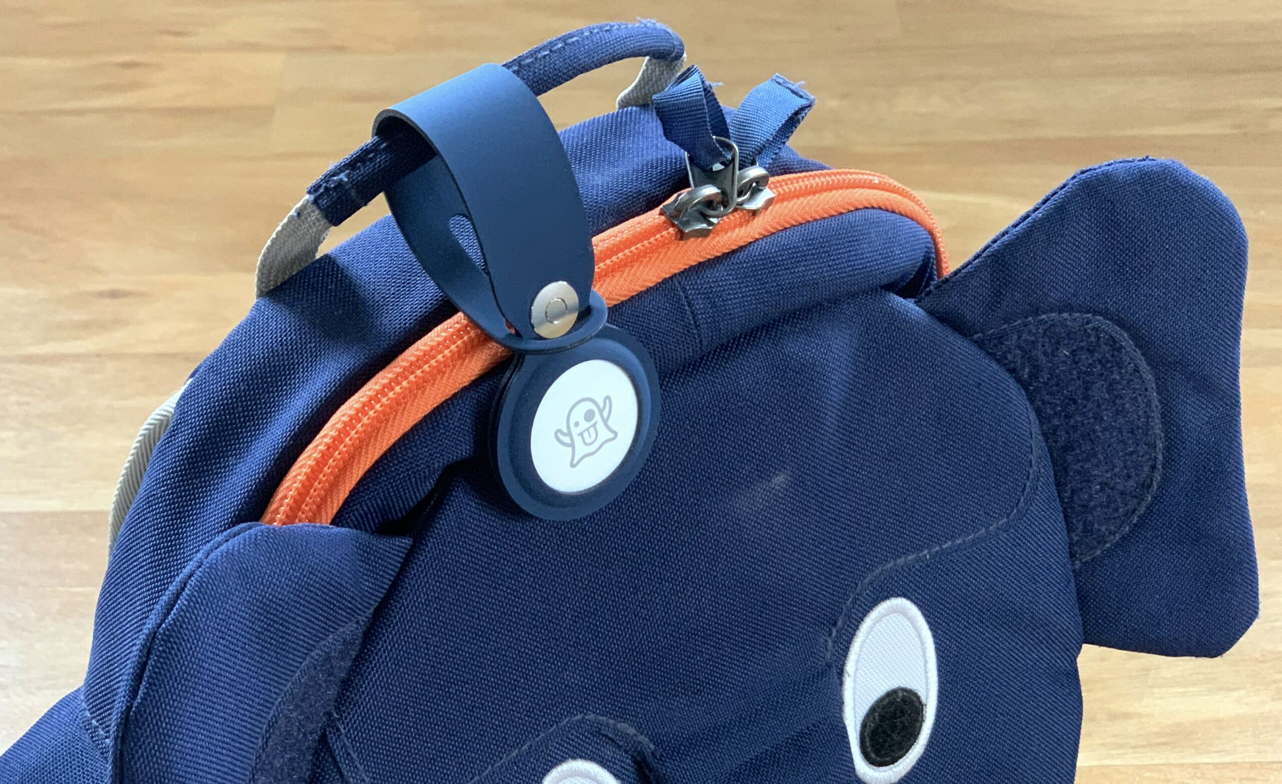Apple AirTag on backpack